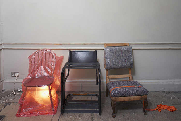 Aubrey Haskard 'Chair 1, 2, 3' 2019, latex resistance bands, furniture blankets, surround wrap, bin liner, anglepoise lamp, photo by Andy Keate