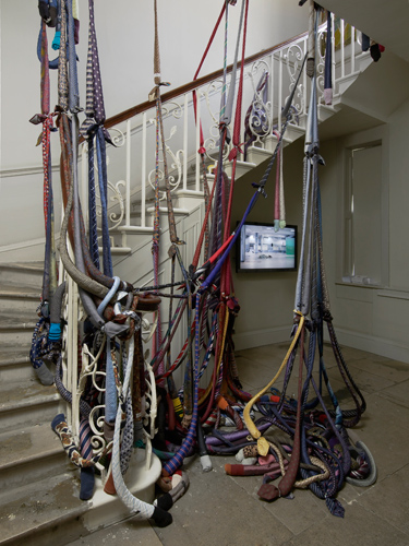 Mhairi Vari 'LOL Memory' silk ties, socks, jubilee clips, e.p.s. beads, dimensions variable, 2013; Ailbhe Ní Bhriain 'Untitled (departure)' hd video, colour, sound, 11:25 min 2013, photo by Andy Keate